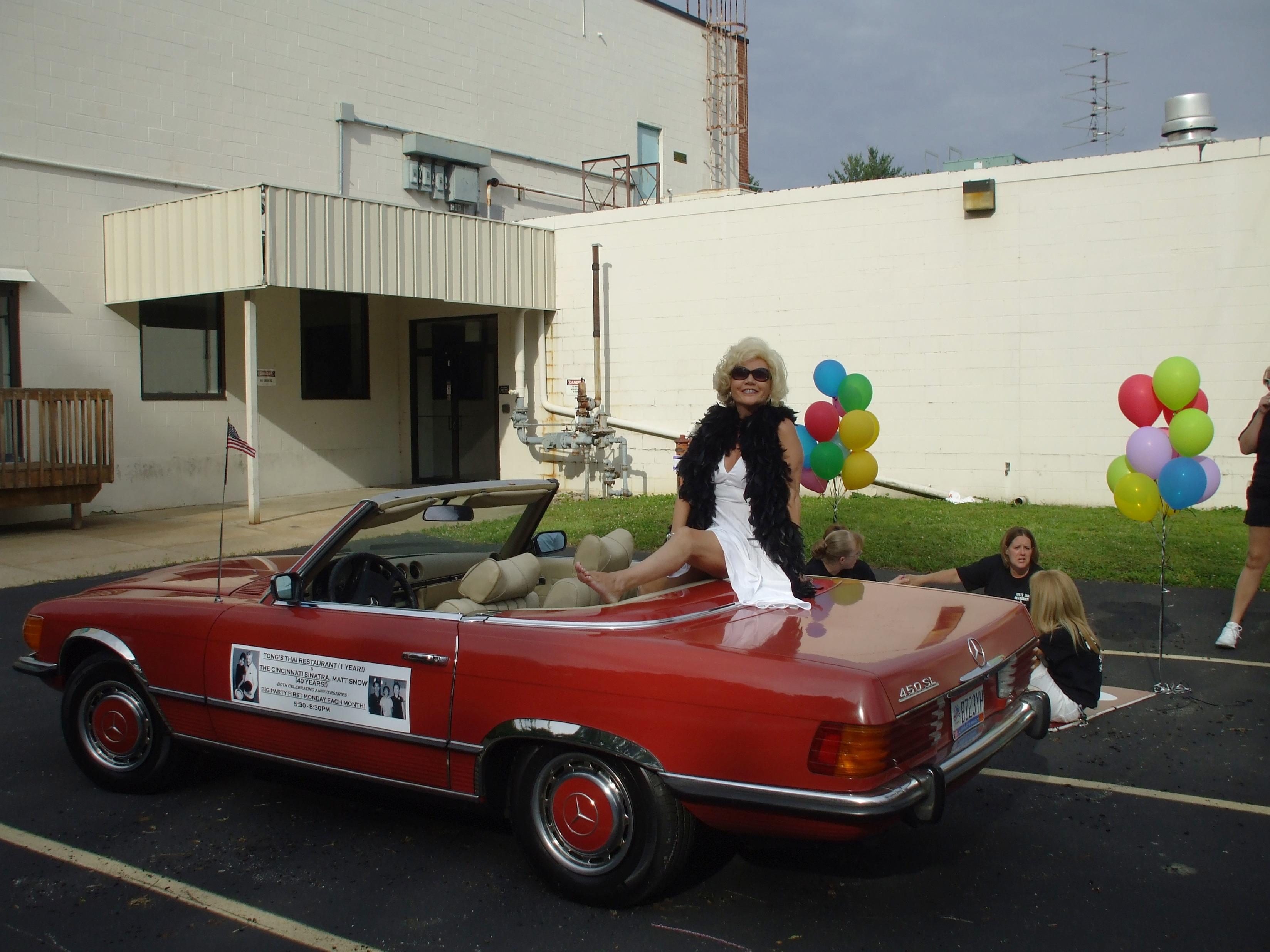 Marilyn gives 'em a little leg at parade 1